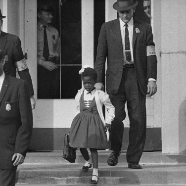 6 year old Ruby Bridges and marshals leaving William Frantz Elementary School, New Orleans, 1960. She was escorted to and from the school daily while segregationist protests continued.Photo: Uncredited DOJ photographer
